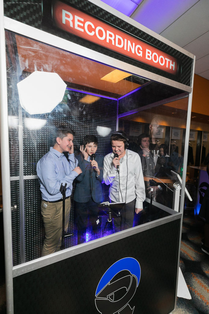 karaoke booth with boys singing