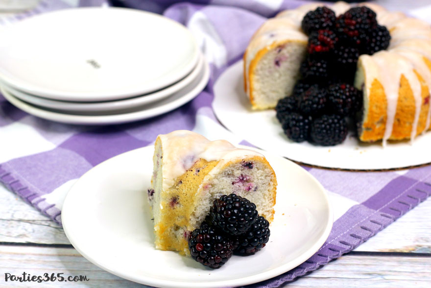 blackberry vanilla bundt cake on a white plate