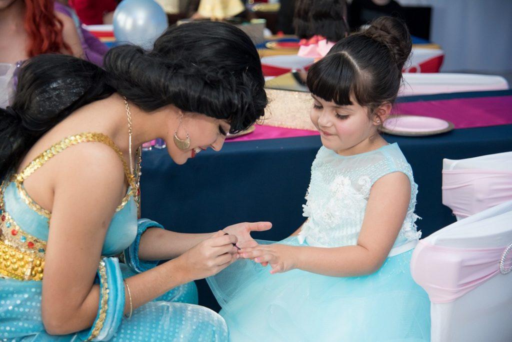 Jasmine painting nails