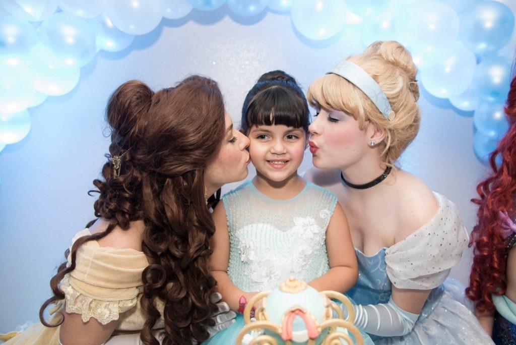 Disney princesses kissing birthday girl