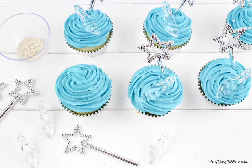 adding glass slippers and magic wands to cinderella cupcakes