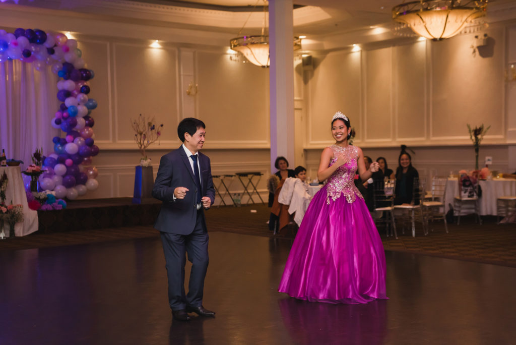 18th birthday party dancing father with daughter in magenta gown