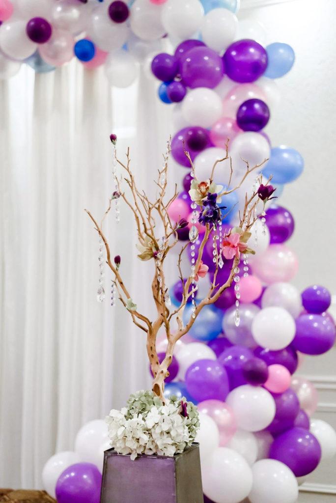 purple and white balloon garland