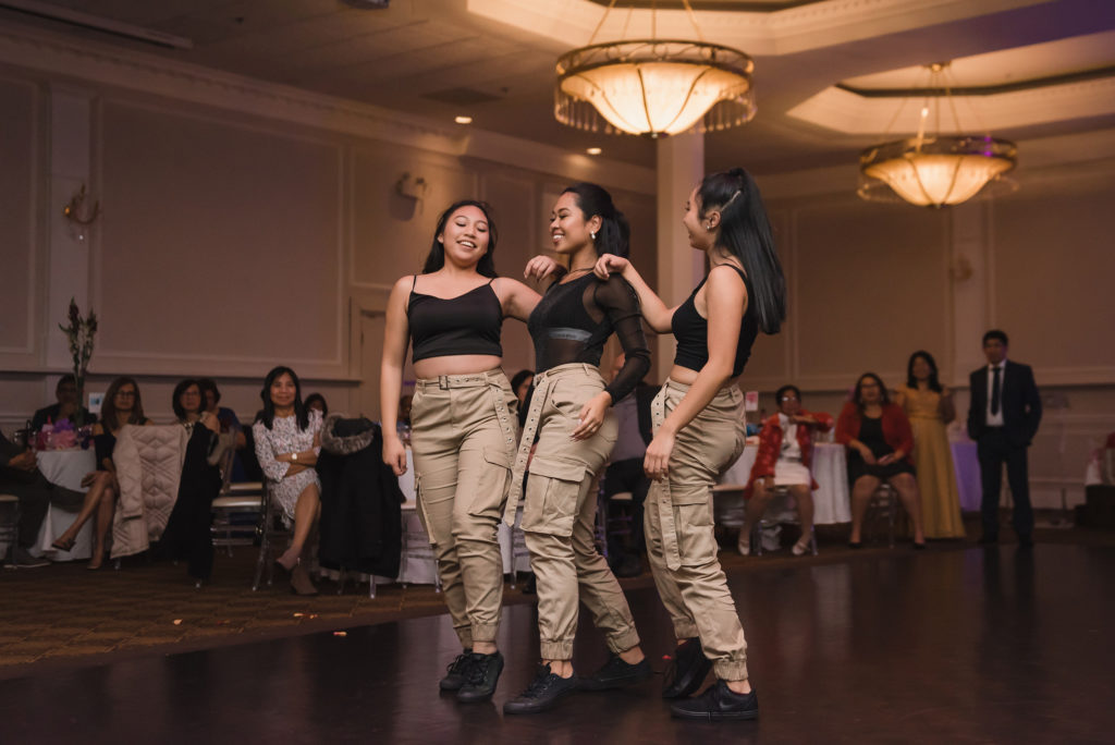 3 girls performing a dance routine