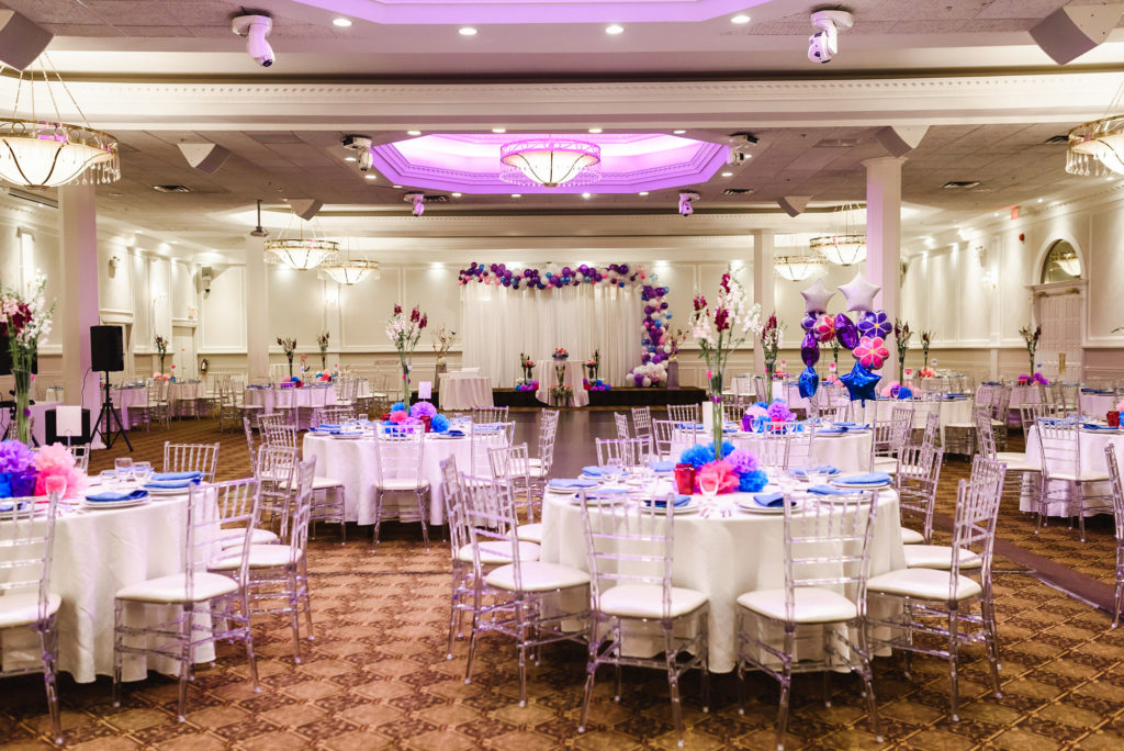 banquet room decorated in purple and pink for 18th birthday party