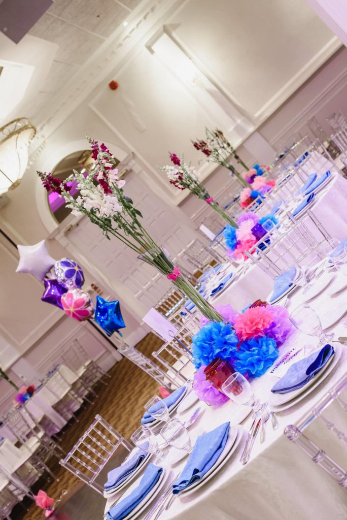 18th birthday party table decor in blue, purple and pink