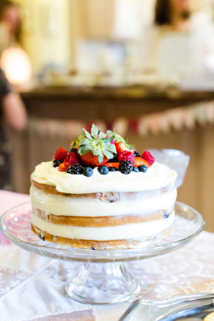 baby shower layered cake topped with fresh berries