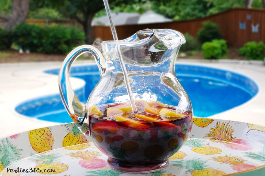 pitcher of red wine sangria by the pool