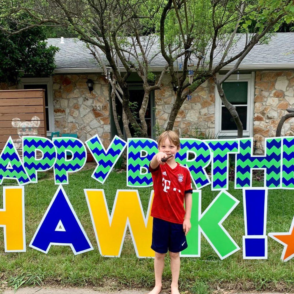 boy in front of yard birthday card