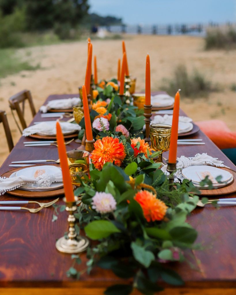 summer tablescape centerpiece with orange candles and flowers