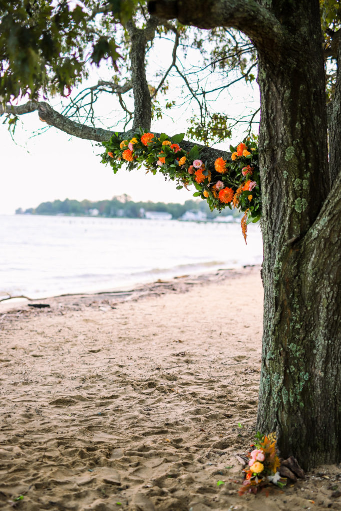 outdoor photo backdrop with summer florals on a tree