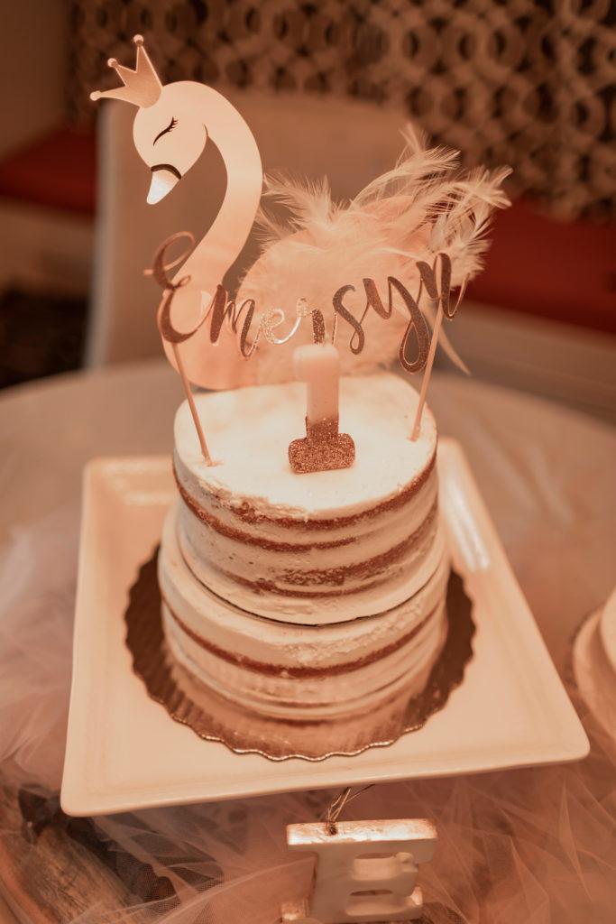 swan cake topper on naked cake