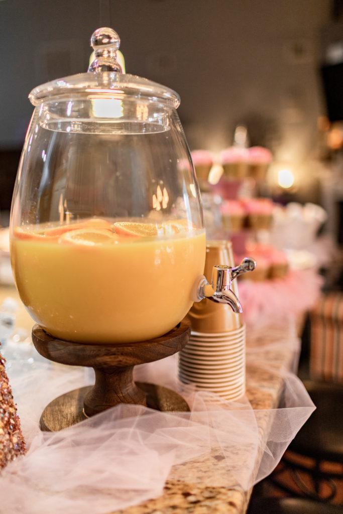 pitcher full of orange juice