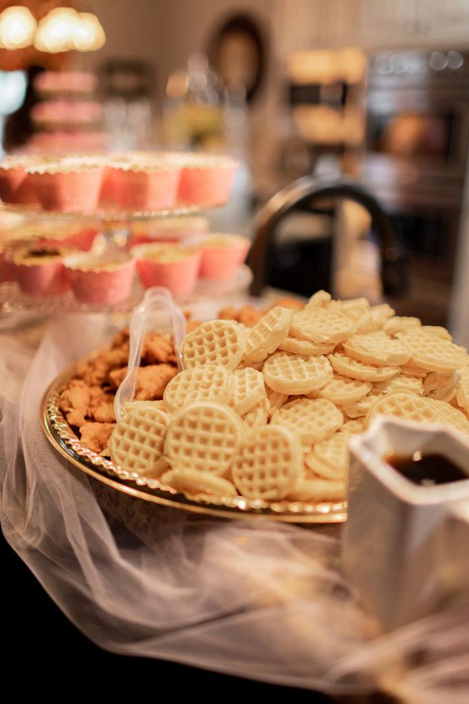 tray of waffles on a breakfast buffett