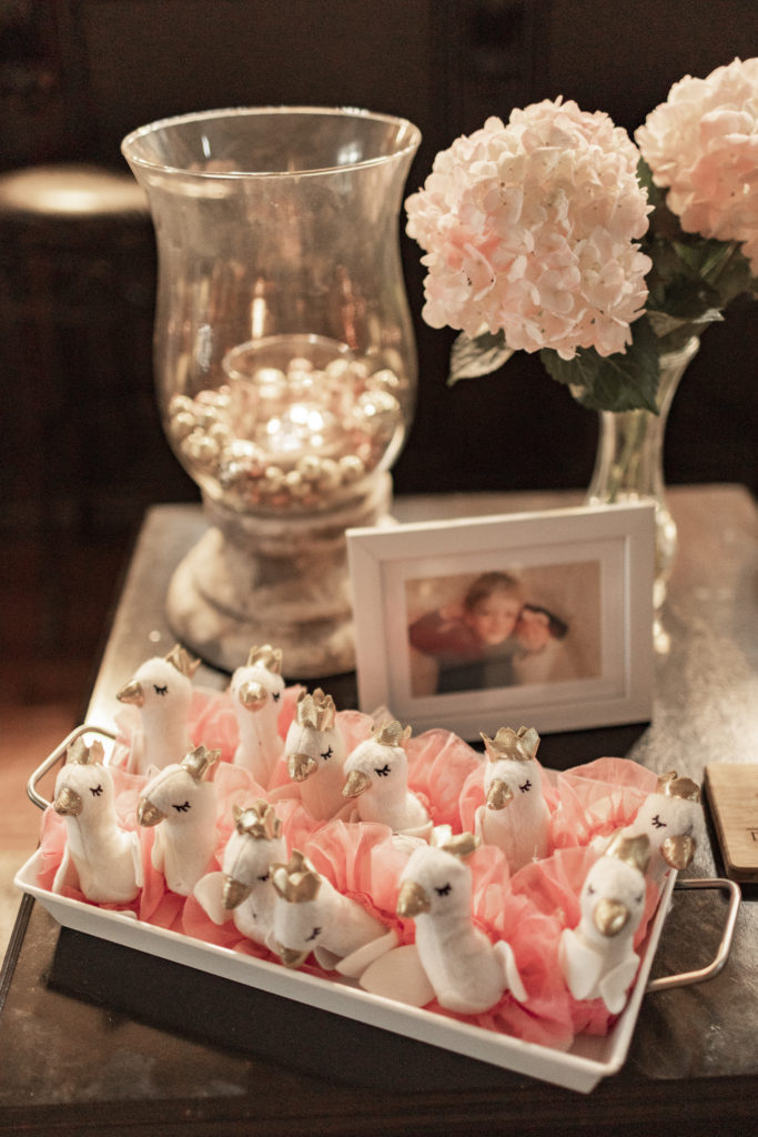 swan stuffed animal party favors in a tray