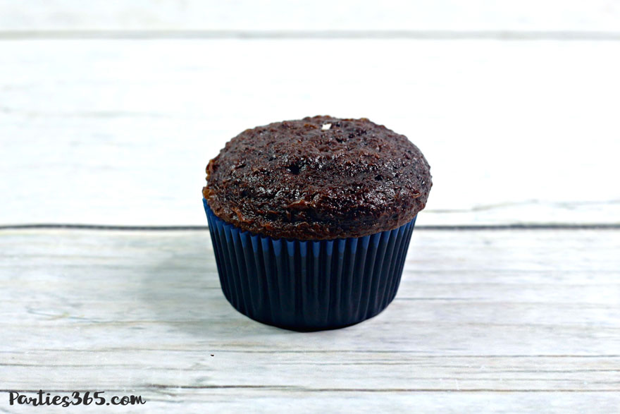 chocolate cupcake in navy blue cupcake liner