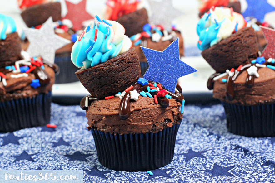 red white and blue chocolate cupcake topped with brownie bite and blue glitter star