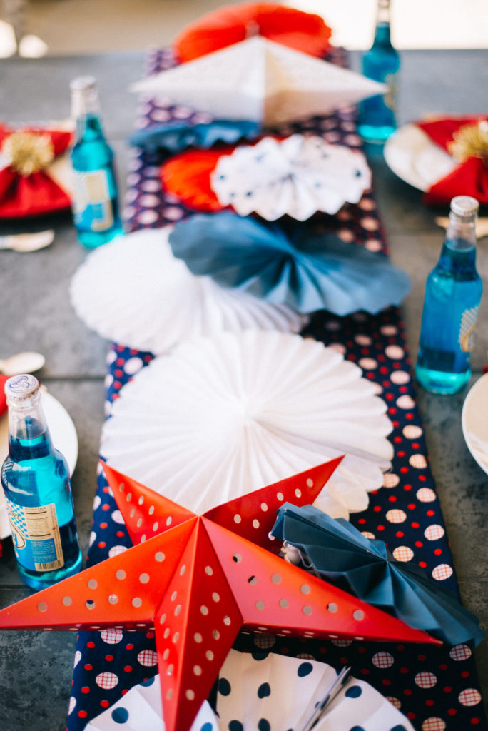 red, white and blue paper fans for patriotic centerpiece