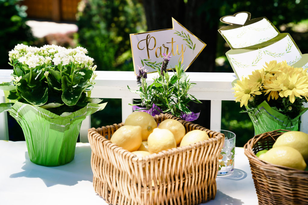 lemons in basket with anniversary party decor