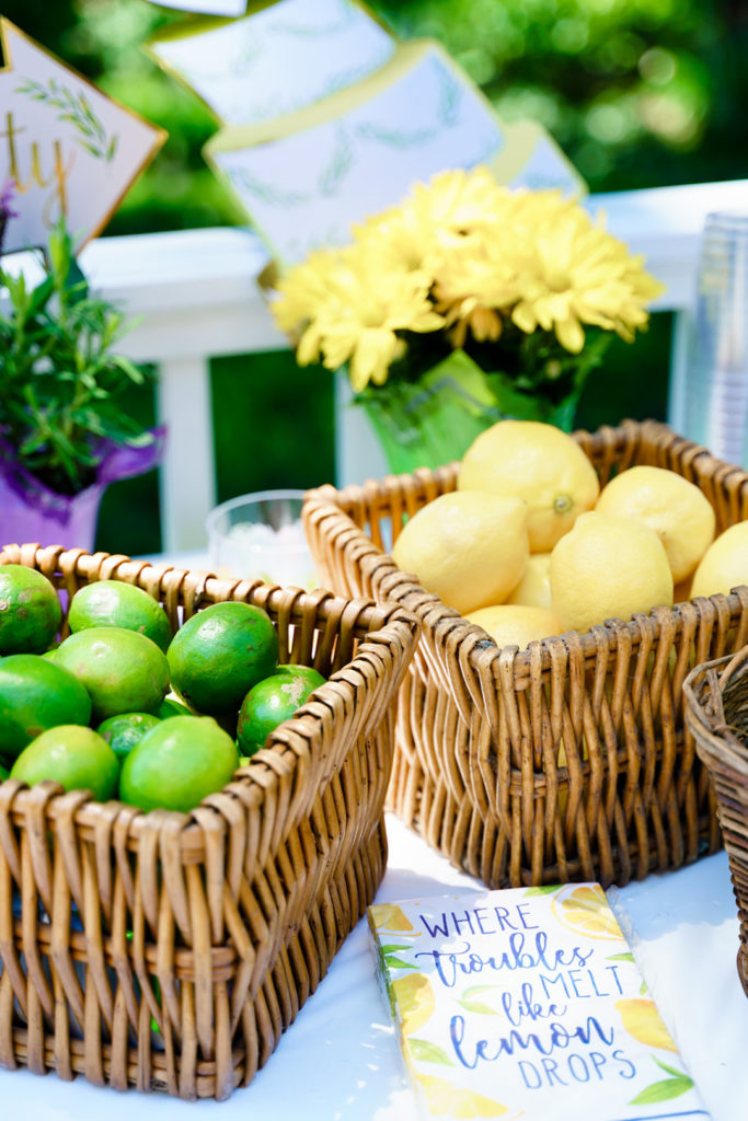 lemons and limes in wicker baskets on table