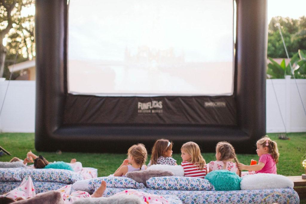 backyard movie screen at birthday party