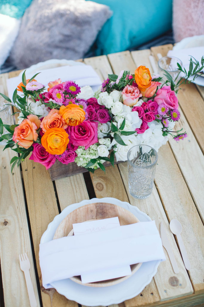 summer floral centerpiece on wooden pallet table