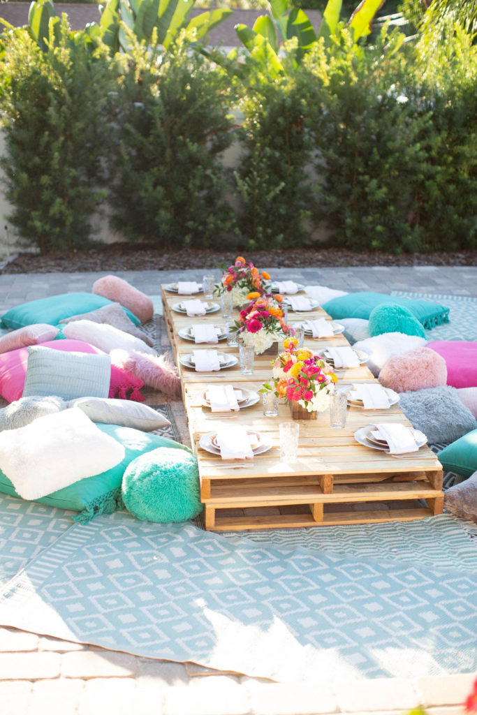 wooden pallet table with pillows for bohemian low seating at outdoor party