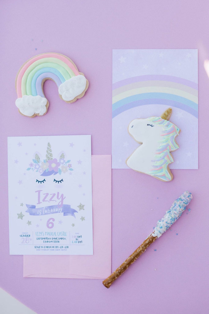 magical unicorn pastel birthday party invitation and desserts