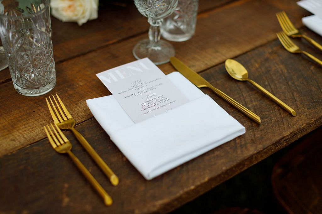 simple white place setting on rustic wooden table