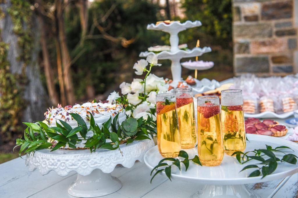 stemless champagne glasses on dessert table at bridal shower
