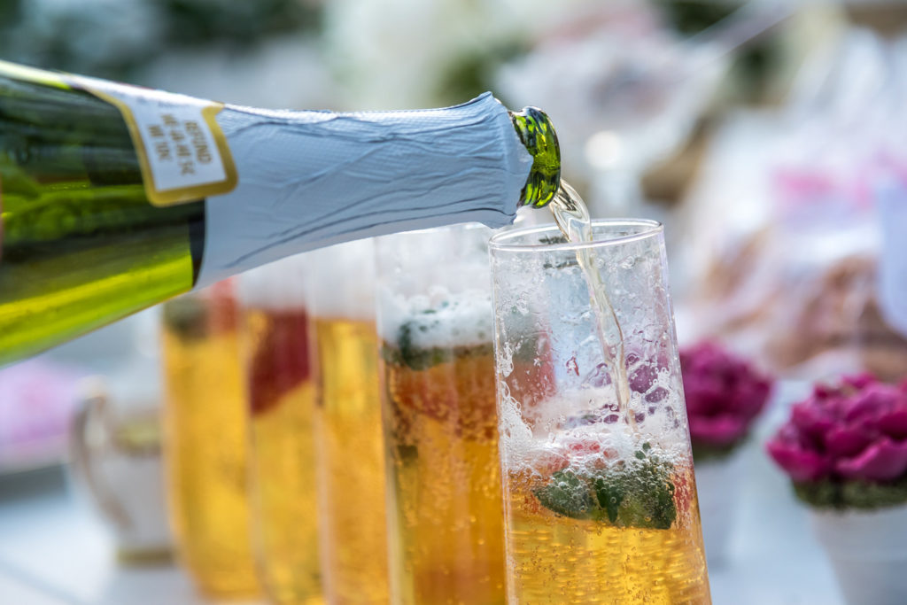pouring champagne drinks