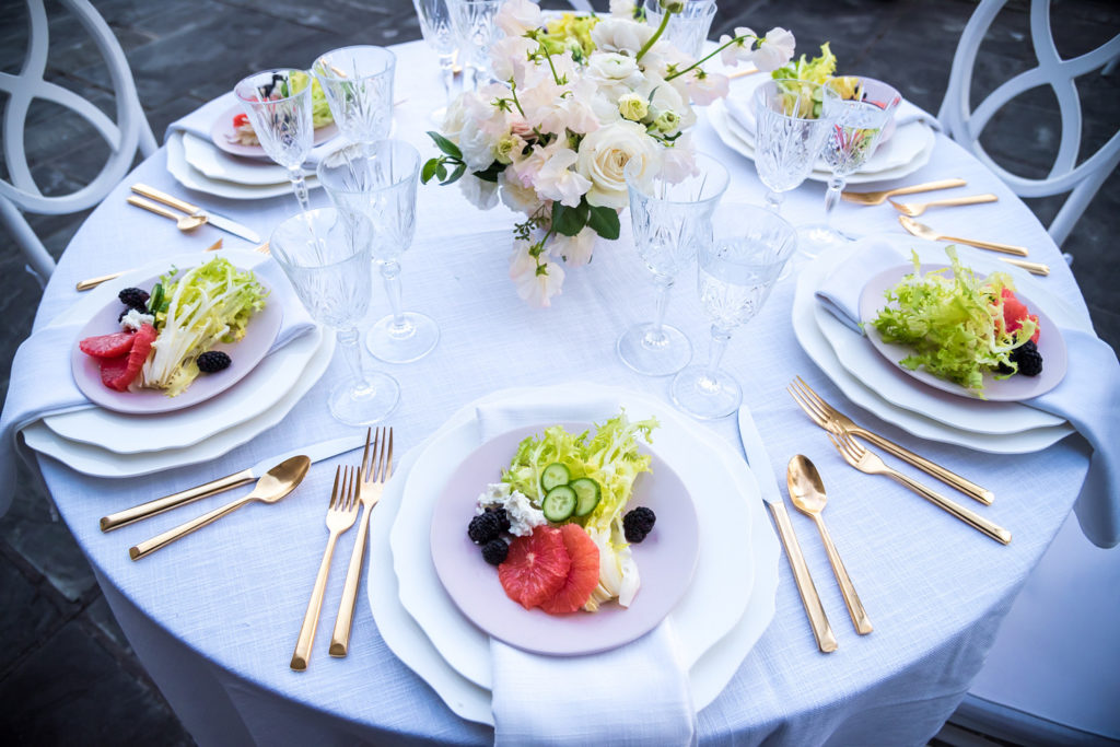 salads on pink plates at bridal shower