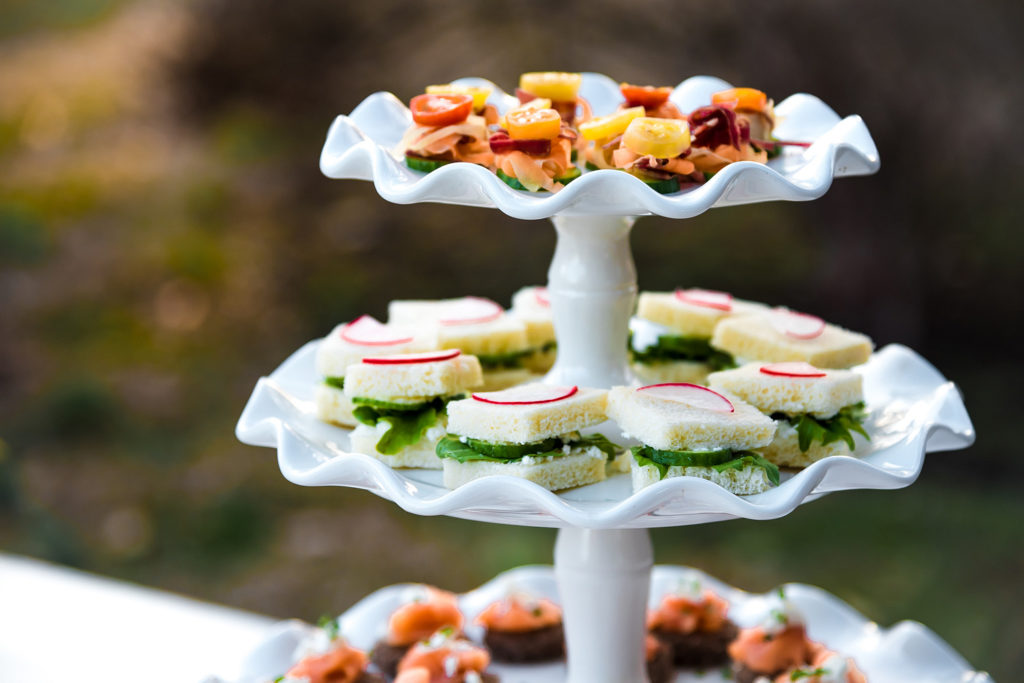 tea sandwiches on tiered tray at bridal shower