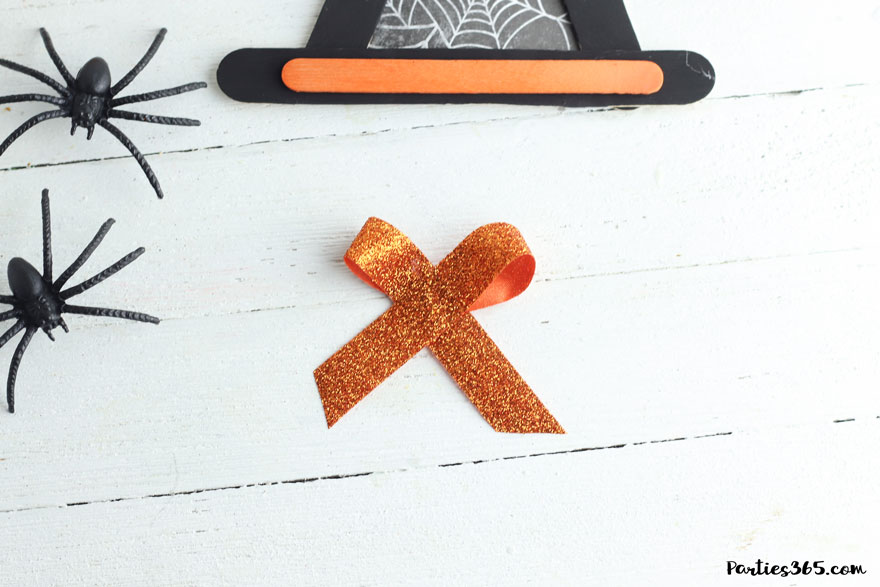 orange ribbon in bow for Halloween craft