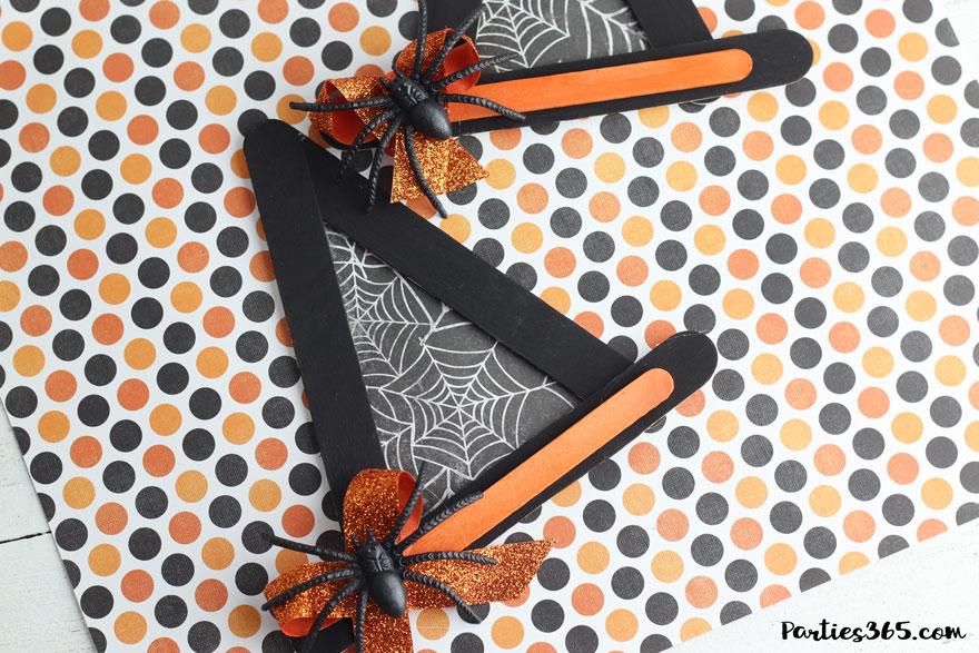 Orange and black halloween witch hat craft with spider