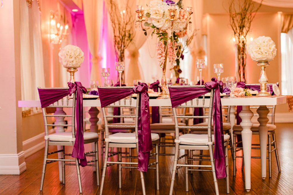 purple sashes on chairs at baby shower