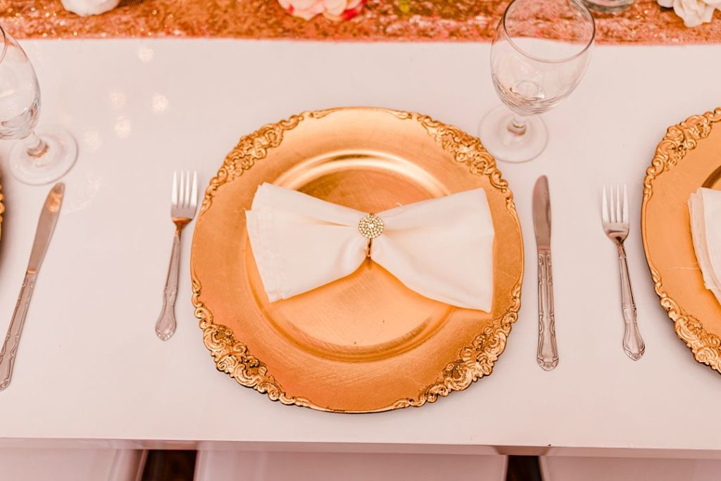 vintage gold charger plate with white napkin