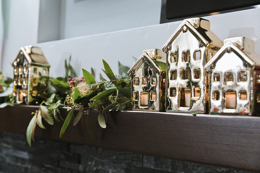 Christmas mantle with gold houses