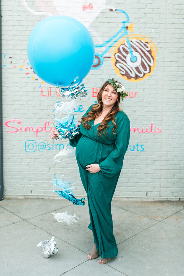 mom to be at donut baby shower