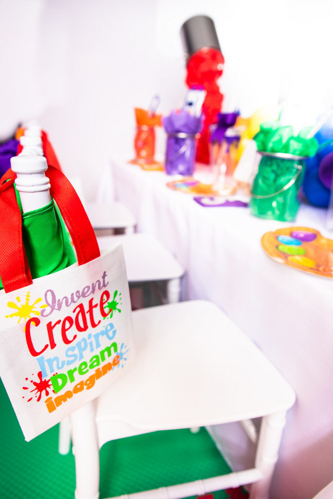 creative party favor bags hanging from white chair