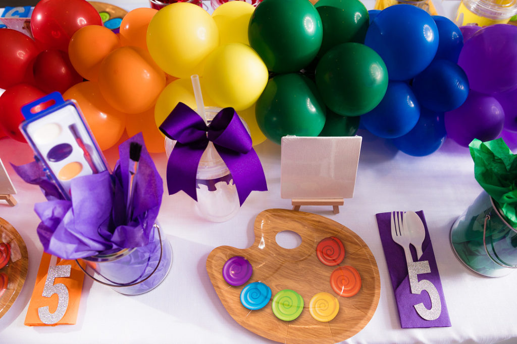 painting party place setting with palette plates