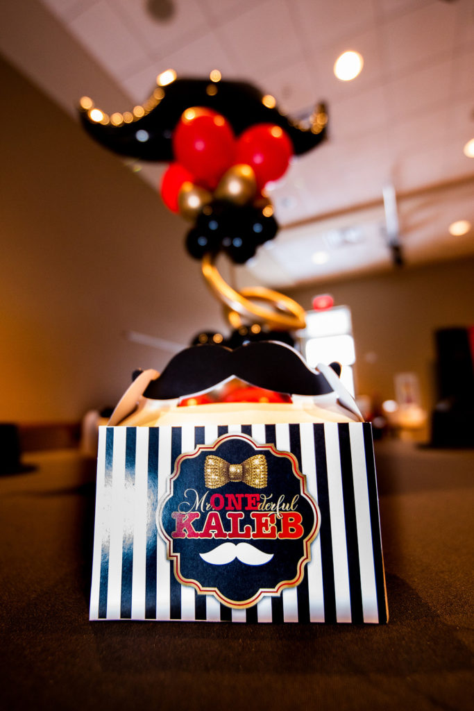 Mr. Onederful party favor box and balloons