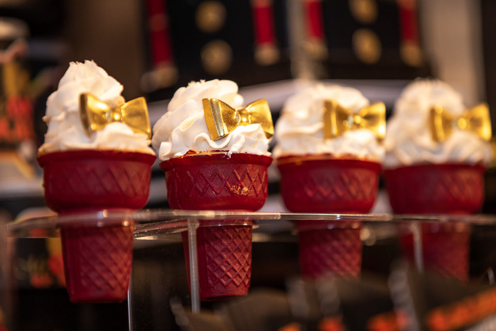 ice cream cone cupcakes with gold bow ties