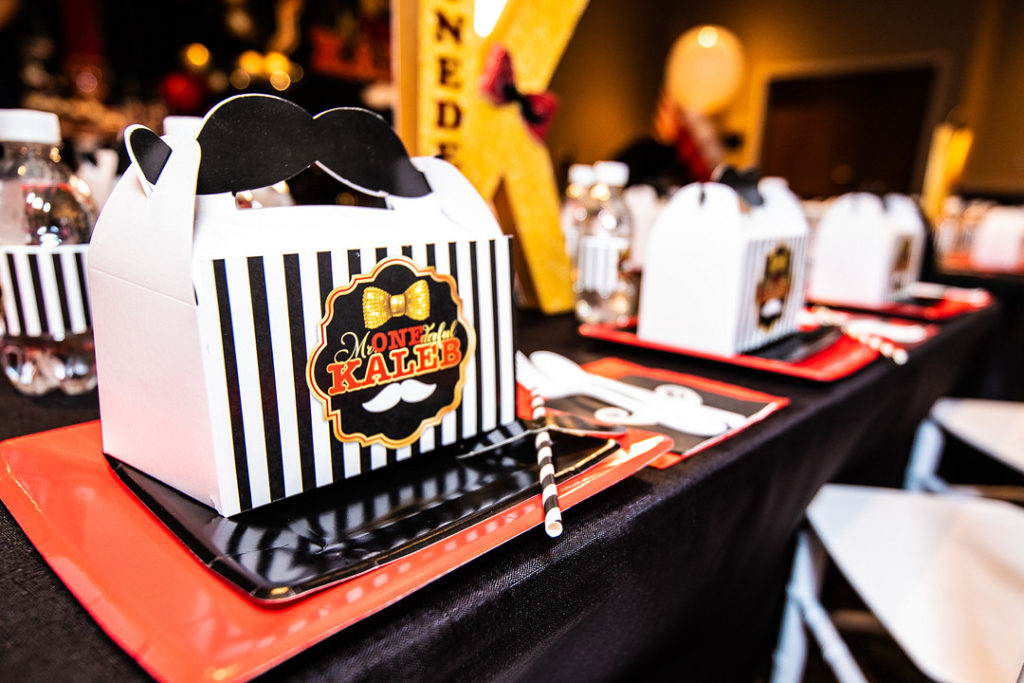 mr. onederful 1st birthday party table setting with favor box
