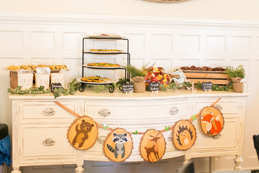 woodland creature party banner on food serving table