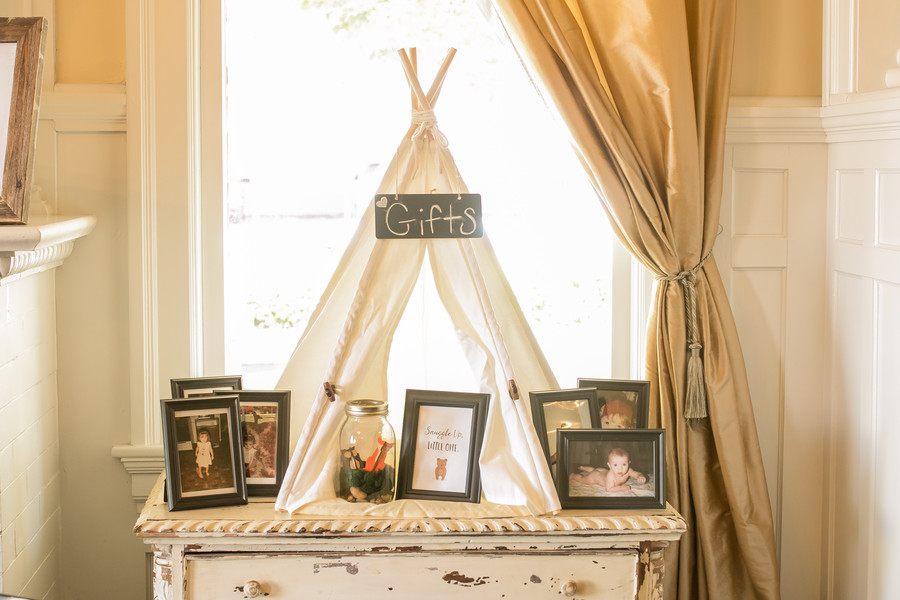 baby shower gift station created with a white canvas teepee