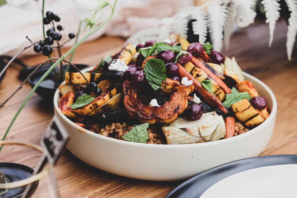roasted root vegetables in white bowl on wooden table