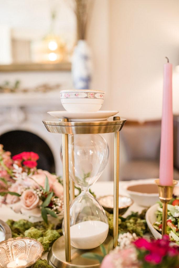 alice in onderland hourglass and tea cup centerpiece