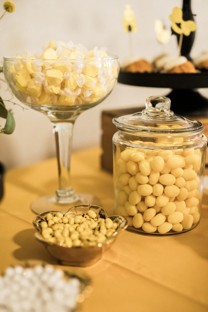 yellow candies in glass jars