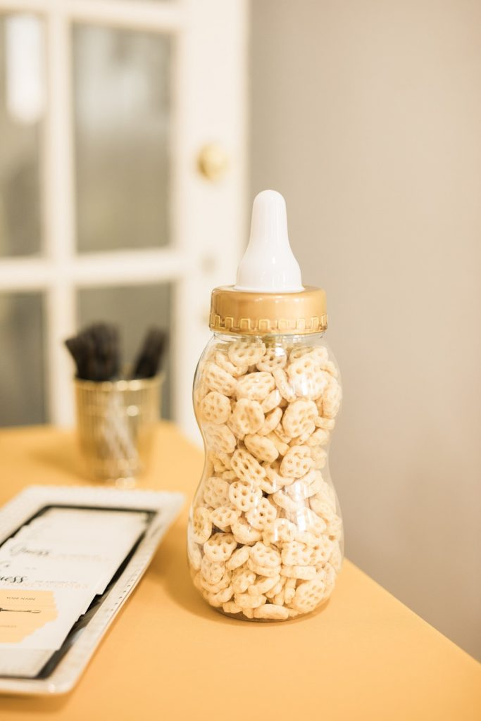 honeycombs in baby bottle for guessing game at shower